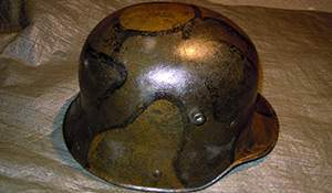 Found: WWI helmets from the scrap-heap. Photos