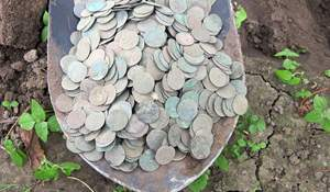 Spadeful of coins. Such things also happen while hunting